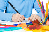 Children's hands with drawing and pencils — Stok fotoğraf
