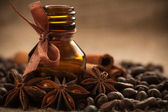 Bottle coffee aroma oil with aromatic coffee beans — Stock Photo