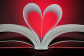 Sign of heart with book pages on the red — Stock Photo