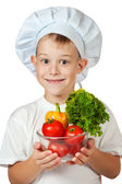Cute scullion is holding fresh vegetables — Stock Photo