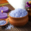 Spa and wellness setting with candles and towel — Stock Photo