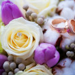 Two beautiful golden rings on wedding boquet — Stock Photo #21076765