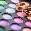 Makeup kit for eyes and wedding rings — Stock Photo