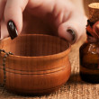 Woman's hand with a bottle of essential oil — Stockfoto