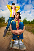 Funny couple are sledding at summer — Stock Photo