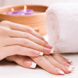 Stock Photo: Female hands with aromatic candles and towel. Spa