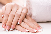 Female hands with towel. Spa — Stock Photo