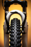Bicycle wheel with suspension fork and brakes — Stock Photo