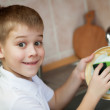 Little boy is washing dishes in the kitchen — Stock Photo
