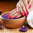 Female hands with aromatic candles and towel. Spa — Stock Photo #22683569