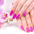 Stock Photo: Manicure with fragrant orchid