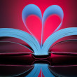 图库照片: Sign of heart with book pages