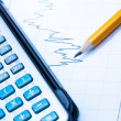 Finance Statistical graphs and calculator — Stock Photo