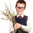 Nice boy in a hurry for a date with a bunch of willow — Stock Photo