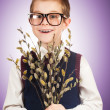 Bespectacled boy  with a bunch of willow — Stock Photo