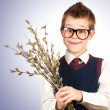 Cute boy  with a bunch of willow — Stock Photo