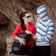 Couple of tourists in the rocky grot — Stock Photo