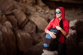 Woman tourist in the rocky grot — Stock Photo