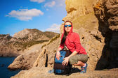 Tired woman tourist is resting on a halt — Stock Photo