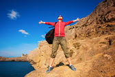 Woman tourist is enjoying landscape with outstretched arms — Stockfoto