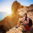 Royalty-Free Stock Photo: Tired woman tourist is resting on a mountain\'s top