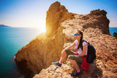 Tired woman tourist is resting on a mountain's top — Stock Photo