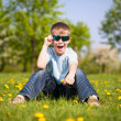 Boy with dandelions in a green park. summer — Stock Photo