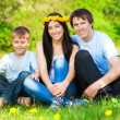 Stock Photo: Happy family in green park. summer