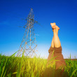 Stock Photo: Female legs against blue sky and power lines