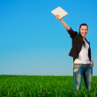 Happy businesswoman in a green field with a laptop. summer — Foto Stock