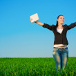 Happy businesswoman in a green field with a laptop. summer — Stok fotoğraf