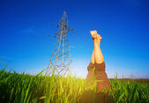 Female legs against the blue sky and the power lines — Stock Photo