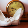 Elegant white wedding shoes composition — Stock Photo