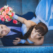 Portret of happy newlyweds on stairs. top view — Stock Photo #26897283