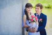 Bride and groom are hugging on stairs — Stock Photo