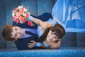 Portret of happy newlyweds on stairs. top view — Stock Photo