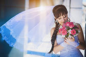 Bride against a blue modern building — Stock Photo
