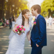 Happy newlyweds in the green park — Stock Photo