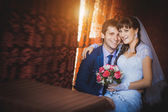 Bride and groom are hugging in the classic interior — Stock Photo