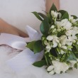 Bridal bouquet in the the bride's hands — Stock Photo #29165763