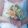 Wedding bouquet in the the bride's hands — Stock Photo #29166347