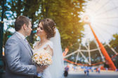 Bride and groom are hugging in the park — Stock Photo