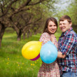 Happy loving couple on a spring meadow — Stock Photo