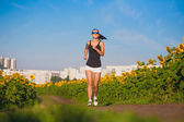 Cute athlete on morning jog in the field — Stockfoto