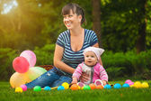 Happy family are playing on the green grass — Stockfoto