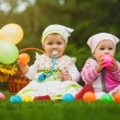 Stock Photo: Cute babies are playing on green grass