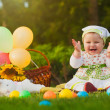 Happy baby is playing on the green grass — Stock Photo