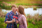 Happy loving couple are kissing near the Lake — Stock Photo