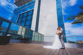 Bride and groom near the building — Stock Photo