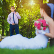 Happy bride and groom in the green park — Stock Photo